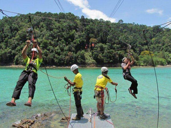 Zipline riders coming into land in Kota Kinabalu