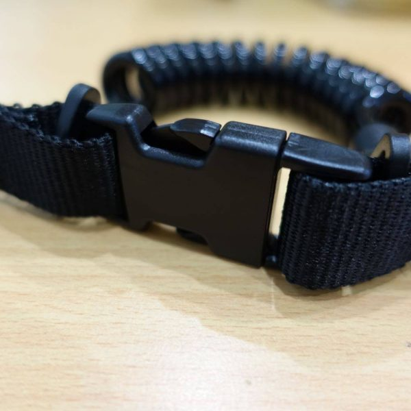 Quick release buckle on coiled lanyard