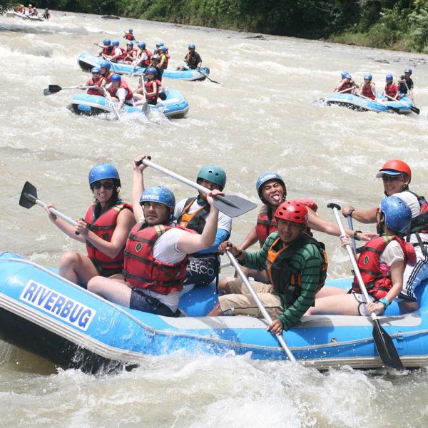 Relax with family friendly white water rafting in Sabah, Borneo.