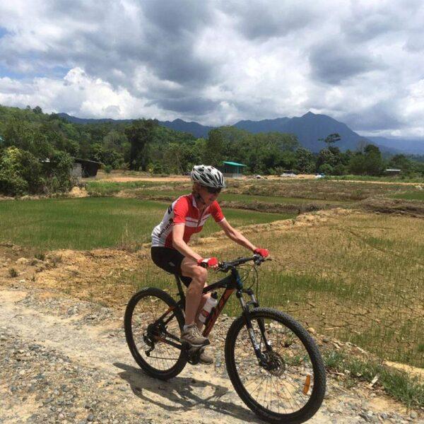 Mountain Biking by Padi Fields in Sabah, Borneo